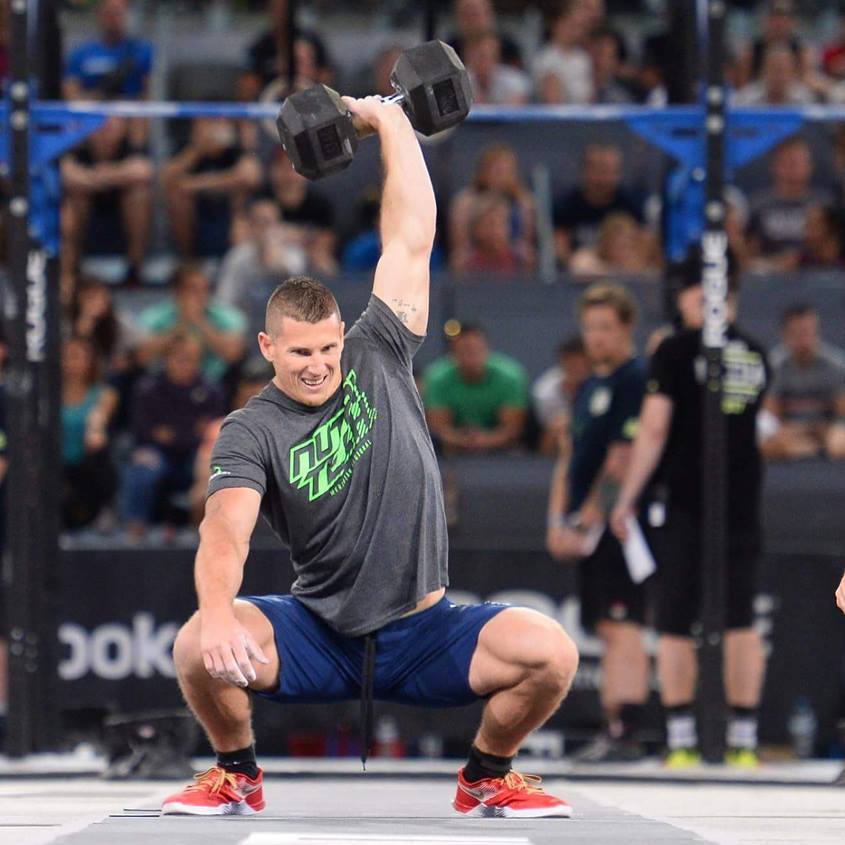 Jason Smith performing one-arm, overhead dumbbell squat.